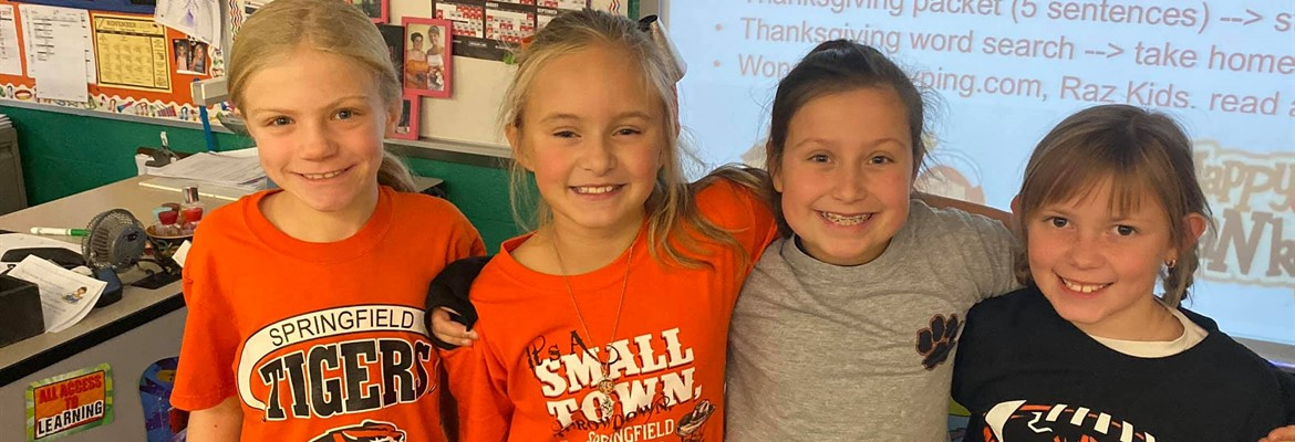 Four third grade female students wearing Tigers shirts.